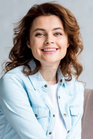 Photo for Front view of excited curly woman in shirt laughing isolated on grey - Royalty Free Image