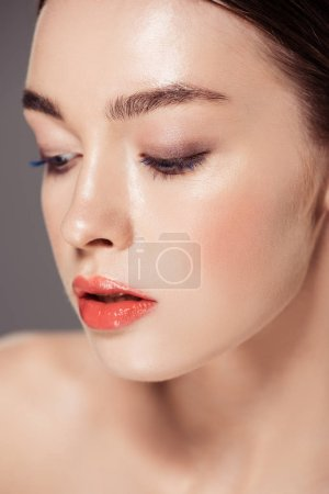 Photo for Portrait of beautiful girl with makeup posing isolated on grey - Royalty Free Image