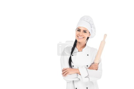 Photo for Chef in uniform holding rolling pin isolated on white - Royalty Free Image