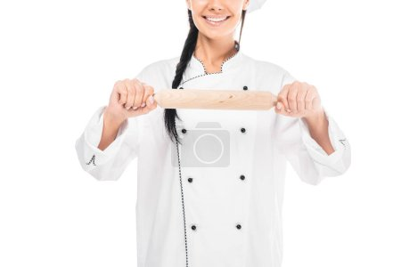 Cropped view of chef in uiform holding rolling pin isolated on white