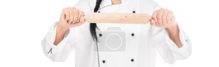 Photo for Panoramic shot of chef in uniform holding rolling pin isolated on white - Royalty Free Image