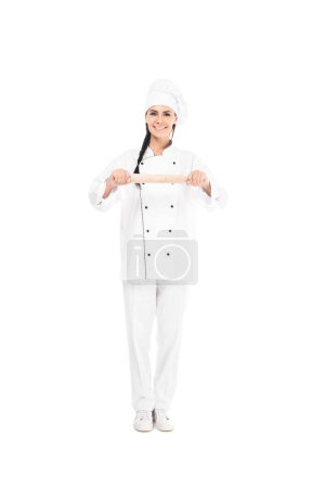 Photo for Full length view of chef in hat holding rolling pin isolated on white - Royalty Free Image