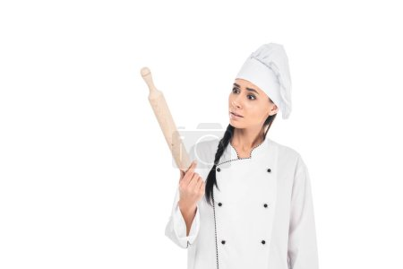 Surprised chef in hat holding rolling pin isolated on white