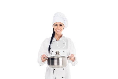 Photo for Smiling chef in uniform holding steel pot isolated on white - Royalty Free Image