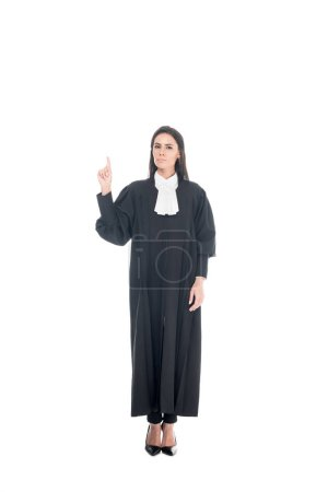 Photo for Full length view of judge in judicial robe showing idea gesture isolated on white - Royalty Free Image