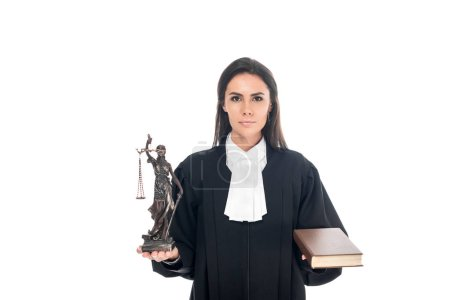 Photo for Judge in judicial robe holding themis figurine and book isolated on white - Royalty Free Image