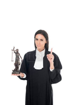 Photo for Judge in judicial robe holding themis figurine and showing idea gesture isolated on white - Royalty Free Image