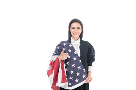 Smiling judge holding american flag and showing thumb up isolated on white