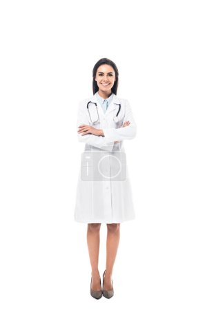 Photo for Full length view of joyful doctor in white coat standing with folded arms isolated on white - Royalty Free Image
