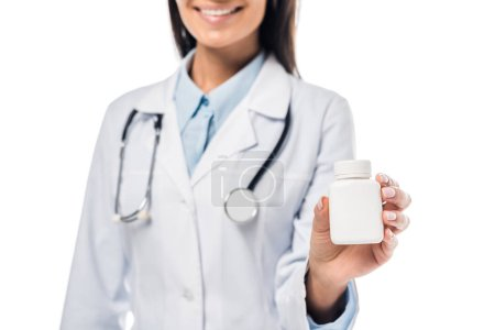 Photo for Cropped view of doctor in white coat with stethoscope holding pills isolated on white - Royalty Free Image