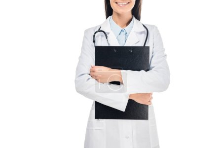 Photo for Partial view of smiling doctor in white coat holding clipboard isolated on white - Royalty Free Image