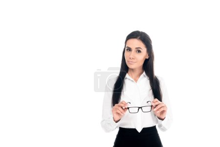 Photo for Interested businesswoman in formal wear holding glasses isolated on white - Royalty Free Image