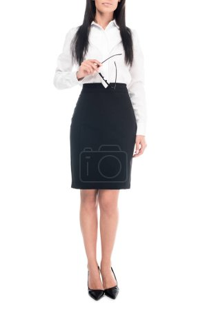 Photo for Cropped view of businesswoman in black skirt holding glasses isolated on white - Royalty Free Image