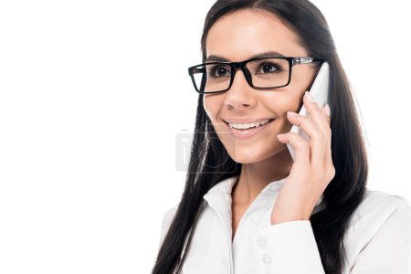 Photo for Smiling businesswoman in glasses talking on smartphone isolated on white - Royalty Free Image
