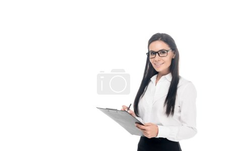 Photo for Beautiful businesswoman in glasses writing on clipboard isolated on white - Royalty Free Image
