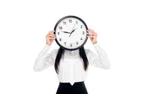 Photo for Brunette businesswoman in shirt holding clock isolated on white - Royalty Free Image