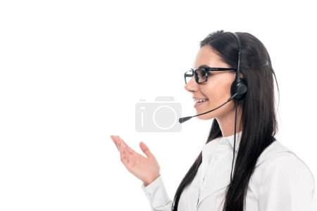 Smiling call center operator in glasses talking on microphone isolated on white