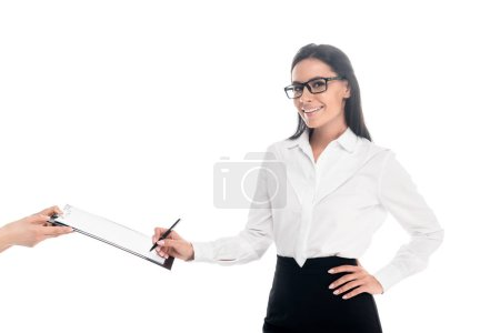 Photo for Smiling businesswoman in glasses signing contract isolated on white - Royalty Free Image