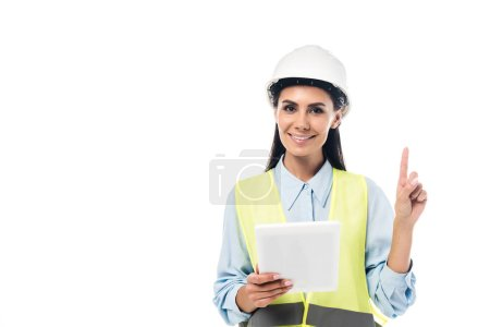 Engineer in safety vest using digital tablet and pointing with finger isolated on white