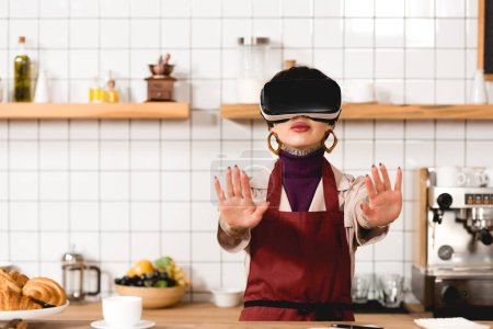 Photo for Barista in virtual reality headset standing near bar counter in coffee shop - Royalty Free Image