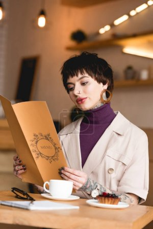 beautiful businesswoman holding menu while