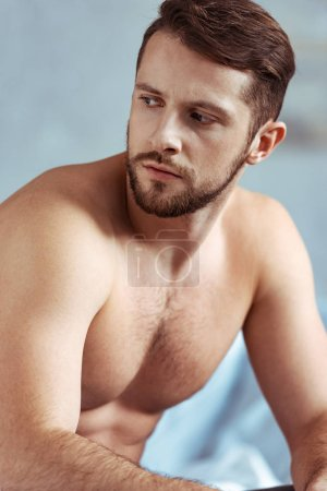 Photo for Good-looking, sexy, shirtless and muscular man looking away in bedroom - Royalty Free Image