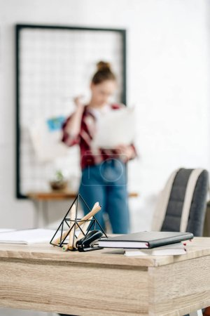 Photo for Selective focus of teenager in jeans and table with notebooks - Royalty Free Image