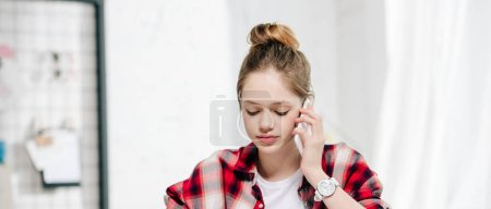 Photo for Panoramic shot of teenager in checkered shirt talking on smartphone - Royalty Free Image