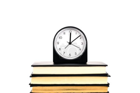 Photo for Clock and stack of books isolated on white - Royalty Free Image