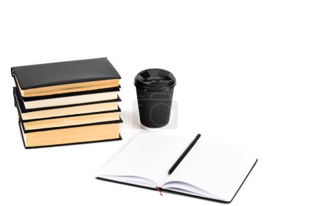 Photo for Stack of books, paper cup, notebook and pencil on white - Royalty Free Image