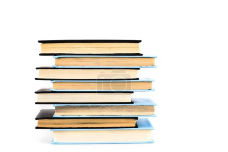 Stack of black and blue books isolated on white
