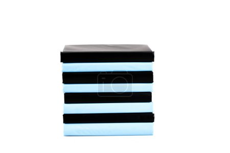 Photo for Stack of black and blue books isolated on white - Royalty Free Image