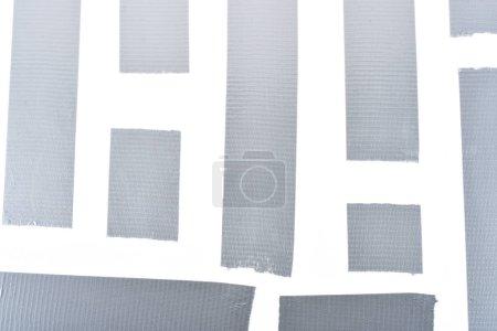 Foto de Fondo con cinta adhesiva de plata aislada en blanco - Imagen libre de derechos