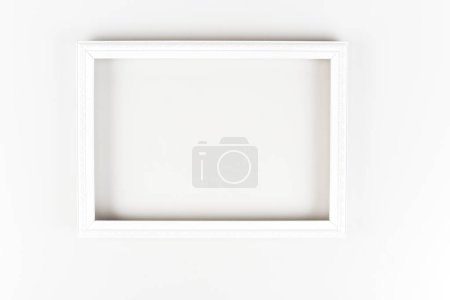 Photo for White decorative frame with ornament on white surface - Royalty Free Image