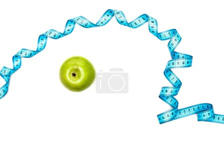 Photo for Top view of green apple and blue measuring tape isolated on white - Royalty Free Image