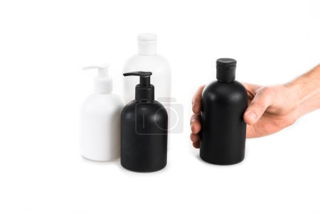 Photo for Partial view of man holding cosmetic bottle on white - Royalty Free Image