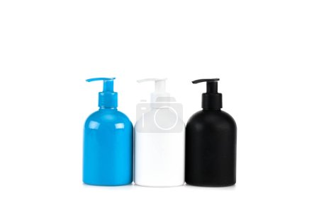 Three cosmetic bottles with sprays isolated on white