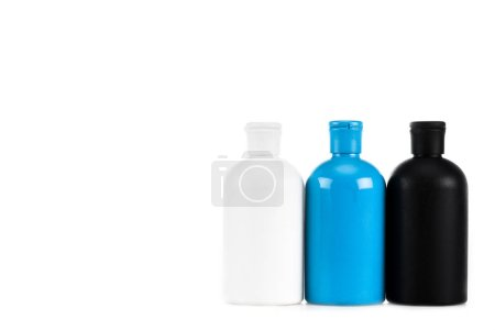 Photo for Three colorful cosmetic bottles with caps isolated on white - Royalty Free Image