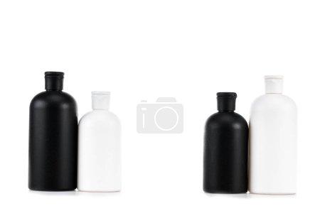 Photo pour Bouteilles cosmétiques noires et blanches isolées sur le blanc - image libre de droit