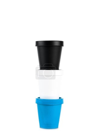 White, black and blue plastic cups isolated on white