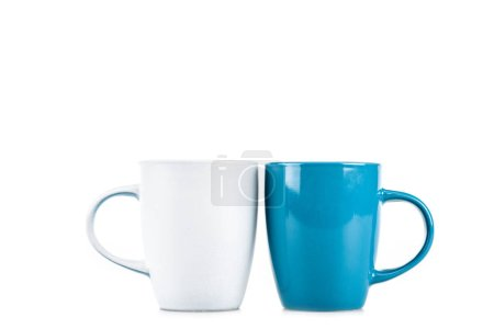 Ceramic white and blue cups isolated on white