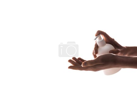 Photo for Cropped view of woman applying hand cream isolated on white - Royalty Free Image