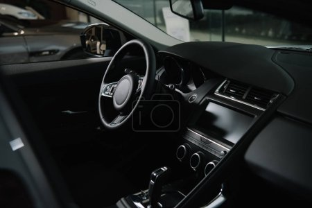Photo for Black steering wheel near gear shift in luxury car - Royalty Free Image
