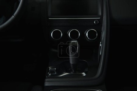 Photo for Modern black gear shift near buttons in luxury car - Royalty Free Image
