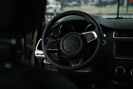 selective focus of steering wheel in luxury car
