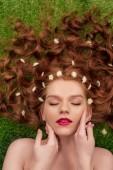 """Постер, картина, фотообои """"красивая молодая Рыжая женщина с красными губами и цветами хризантем в волосах трогательное лицо"""""""