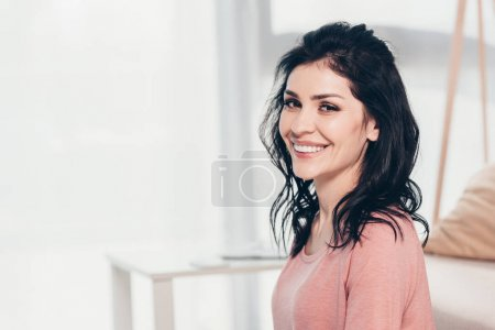 Photo for Beautiful smiling woman in casual clothes looking at camera and smiling at home with copy space - Royalty Free Image