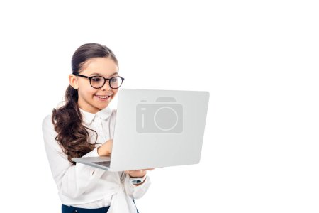 Photo pour Happy schoolchild in glasses using laptop Isolated On White with copy space - image libre de droit