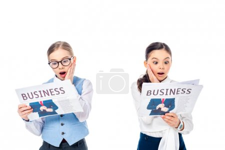 Photo for Shocked schoolgirls in formal wear reading business newspapers Isolated On White - Royalty Free Image