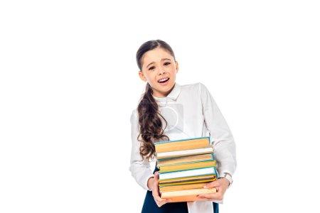 Photo pour Écolière dans l'usure formelle regardant l'appareil-photo et retenant des livres d'isolement sur le blanc avec l'espace de copie - image libre de droit